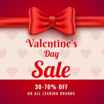 Valentine's day sale poster  with 30-70% discount offer and red bow ribbon decorated  for advertising .