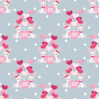 Valentine's day seamless pattern with cute rabbits couple.
