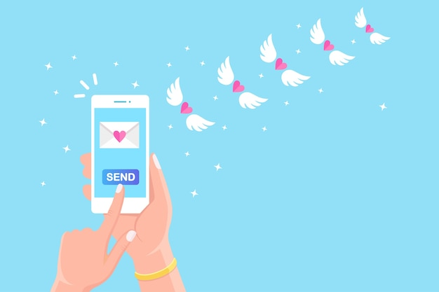 Valentine's day . send or receive love sms, letter, email with mobile phone. white cellphone in hand  on background. flying envelope with red heart, wings.