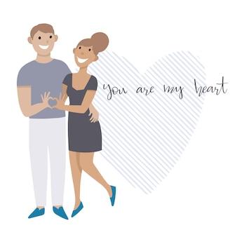 День святого валентина. влюбленная пара. мужчина и женщина показывают сердце своими руками.