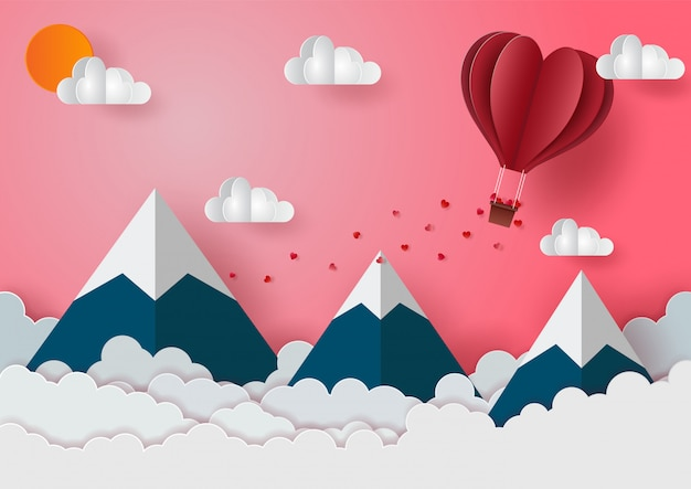 Valentine's day with balloons floating above the mountains