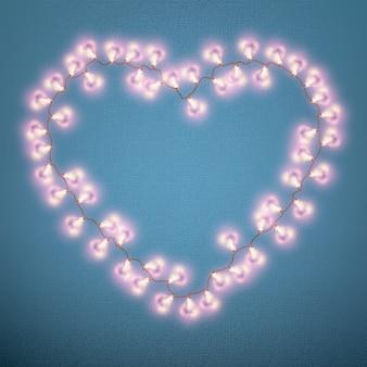 キャンバス上のランプの心で作られたバレンタインのリース。