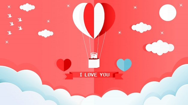 Valentines card of red and white heart shape balloon on the wall in the corner of the room.