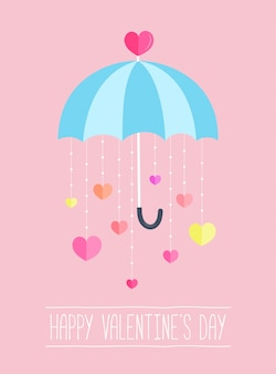 Valentines day background decor by umbrella with a paper hearts hanging down.