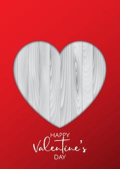 木製の質感の切り欠き心とバレンタインデーの背景