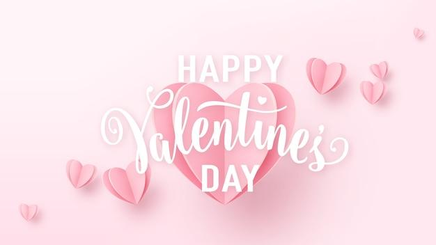 明るいピンクの紙のハートと白いテキスト記号でバレンタインデーの背景。