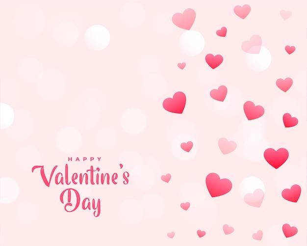 散らばった心とバレンタインデーの美しいカード