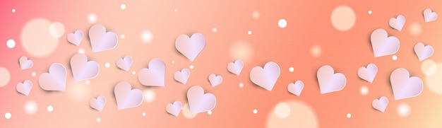 Valentines day bokeh background with pink hearts banner