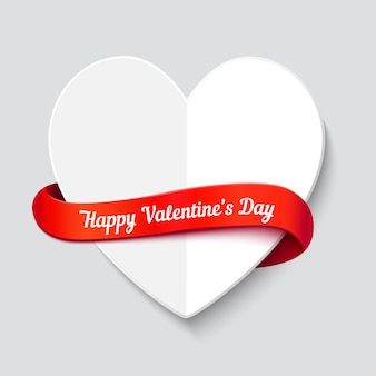Valentines day greeting card. big white paper cut folded heart with red curl ribbon and space for text