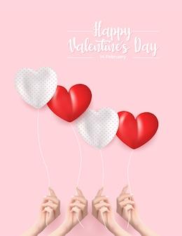 발렌타인 데이 인사말 카드입니다. 현실적인 손에 풍선을 들고입니다.