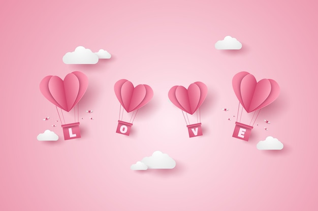青い空を飛んでいる愛のピンクのハートの熱気球のバレンタインデーのイラスト