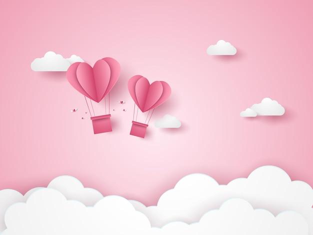 ピンクの空を飛んでいる愛のピンクのハートの熱気球のバレンタインデーのイラスト