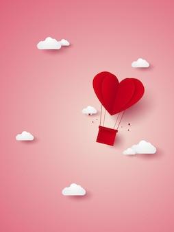 空を飛んでいる愛の赤いハートの熱気球のバレンタインデーのイラストペーパーアートスタイル