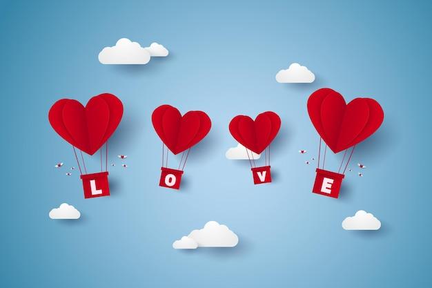 空を飛んでいるレタリングと愛の赤いハートの熱気球のバレンタインデーのイラスト