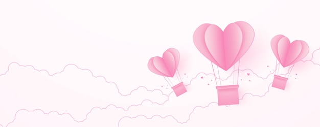 Valentines day love concept backgroundpaper pink heart shaped hot air balloons floating in the sky