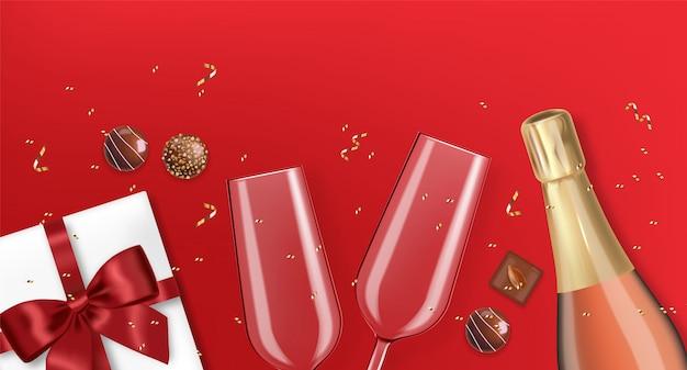 バレンタインの日、ロマンチックで現実的なシャンパングラス、ギフト、チョコレートと赤いリボン、赤い背景、愛の概念
