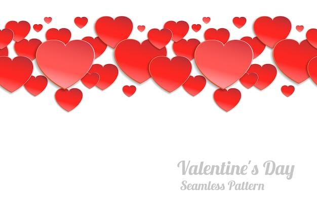 バレンタインデーのシームレスな水平パターン。白い背景の上の赤い紙の心
