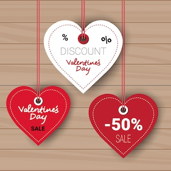 Valentines day set of sale discount tags collection on wooden wall