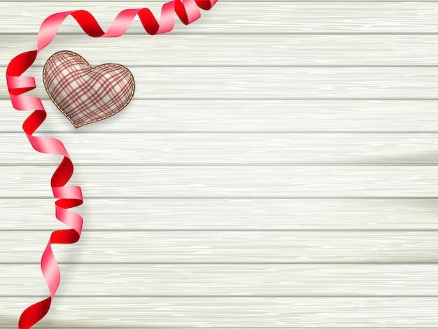 バレンタインの日グッズハートとコピースペースを木製のテーブル背景にリボン。