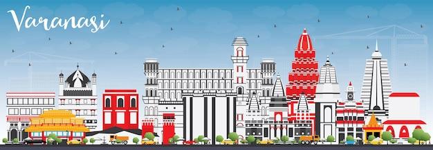 Varanasi skyline with color buildings and blue sky.