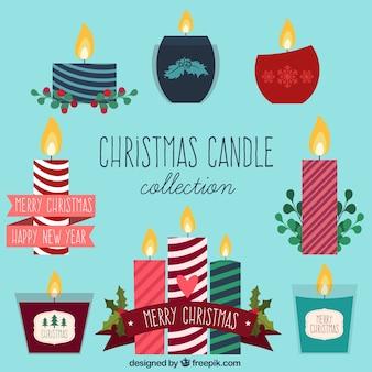Varietà di candele di natale in design piatto