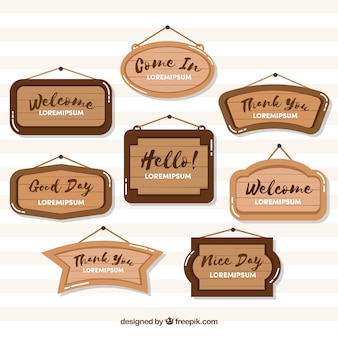 Variety of wooden signs in flat design