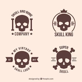 Varietà di loghi cranio in design piatto