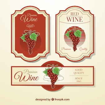 Variety of wine labels with red elements