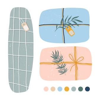 手描きのギフトやプレゼント。クラフト紙、ボックス、リボン、枝、その他の装飾要素。フラットなデザイン。手描きのトレンディなセット。