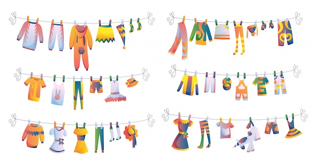 Various items of baby clothes on rope isolated
