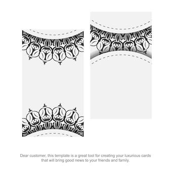 블랙 빈티지 패턴과 화이트 색상의 벡터 명함 디자인. 그리스 장식이 있는 세련된 명함입니다.