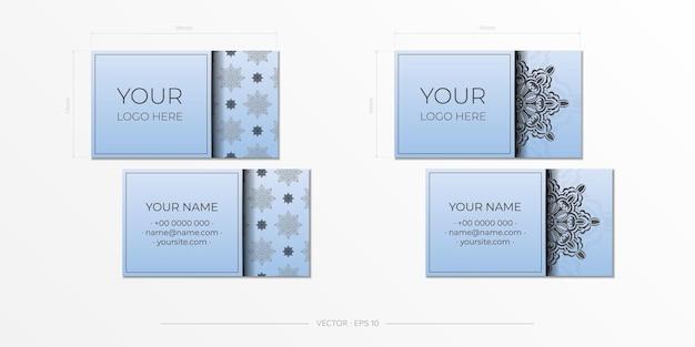 豪華な黒の装飾品と青のベクトル名刺。ヴィンテージパターンの名刺デザイン。