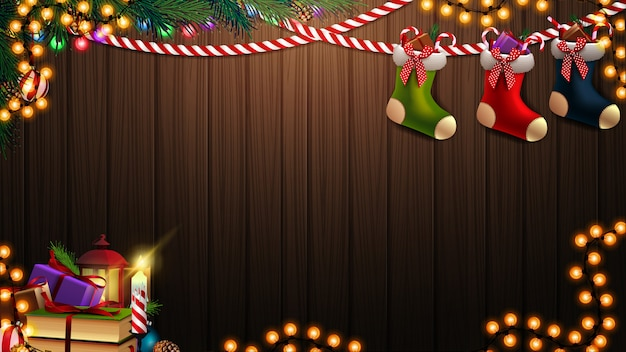 Vector christmas background with garland, branch, books, candle