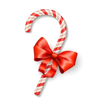 Vector christmas candy cane with red bow isolated on white