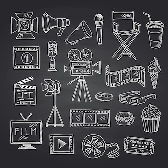Vector cinema doodle elements on black chalkboard illustration