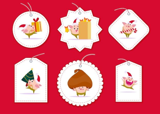 クリスマスギフトタグとバッジのベクトルコレクションは、赤い背景で隔離のさまざまな形をします。クリスマスホリデープレゼントのパッケージのエンブレム。サンタハットキャリーギフト、ツリーの新年の豚のエルフのキャラクター。