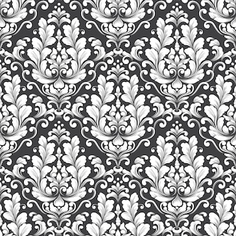 ベクトルダマスクシームレスパターン。古典的な豪華な昔ながらのダマスク織の飾り、壁紙、テキスタイル、ラッピングのロイヤルビクトリア朝のシームレスなテクスチャ。絶妙な花のバロックテンプレート。