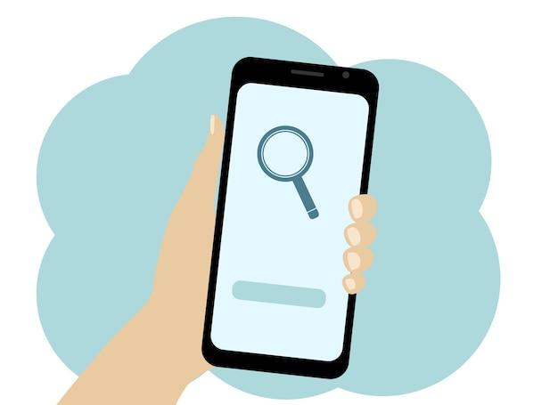 Векторный рисунок руки с мобильным телефоном. ищите информацию в телефоне. значок лупы