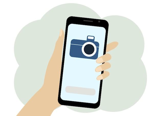 携帯電話で手のベクトル描画。スマートフォン画面上のカメラの画像