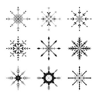 벡터 평면 그림입니다. 새 해와 크리스마스 검은 눈송이 아이콘의 집합입니다. 배경 장식입니다.
