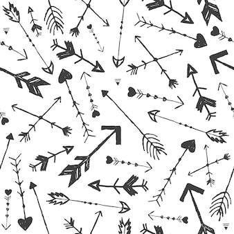 벡터 손으로 그려진된 화살표 완벽 한 패턴입니다. 낙서 빈티지 보호 스타일. 포장, 장식, 배경, 직물에 사용 프리미엄 벡터