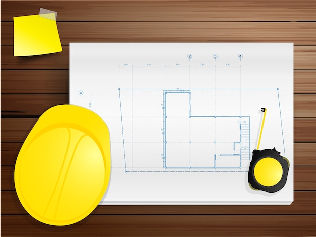 Vector hard hat with blueprints on wood texture background
