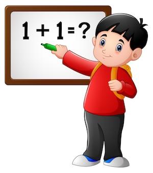Vector illustration of cartoon school boy at blackboard