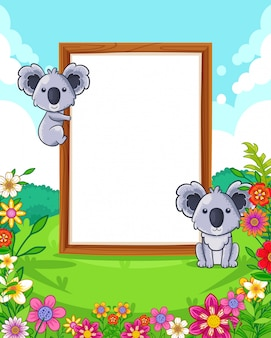 Vector illustration of cute koalas with wood blank sign in the park