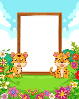 Vector illustration of cute tigers with wood blank sign in the park