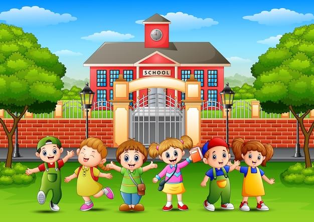 Vector illustration of happy school children standing in front of school building