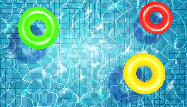 Векторная иллюстрация бассейна с водой и плавающих кругов