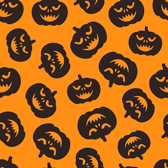 Vector illustration of a pattern of pumpkin faces endless drawing for the halloween holiday