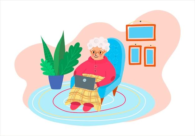 Векторная иллюстрация с милой бабушкой, работающей на портативном компьютере у себя дома в плоском стиле.