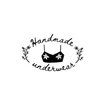 Векторный бюстгальтер с логотипом в стиле рисованной. иллюстрация женского нижнего белья, шаблоны дизайна купальников для магазинов, салонов, рукодельниц, швеи. нижнее белье ручной работы